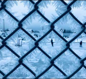 : Chain link fencing with ice crystals